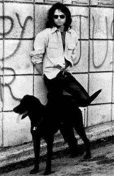 jim morrison in leather trousers with black dog