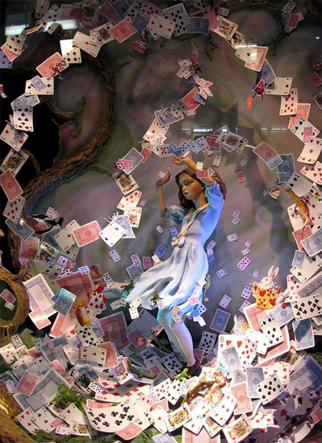 Alice in Wonderland Playing Cards Blowing