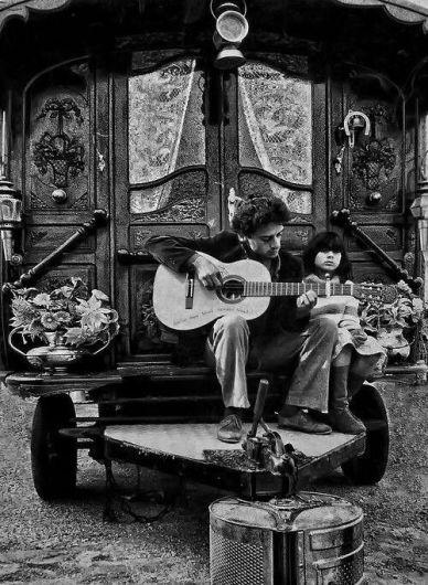 Vintage Gypsy man with child pgoto