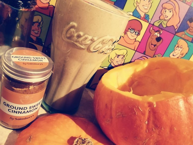 Vegan Pumpkin Halloween Smoothie with Cinammon and Scooby Doo in background